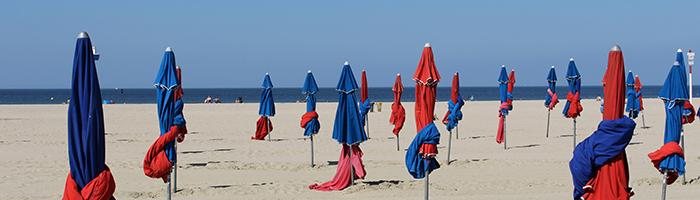 Sun umbrellas on the beach of Normandy