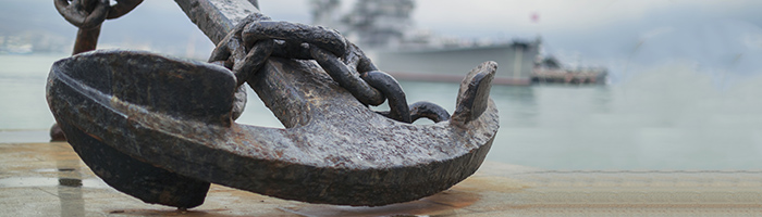 """Anchor on the embankment and the cruiser """"Mikhail Kutuzov""""  in the port of Novorossiysk, Russia"""