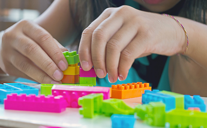 Hand assembled plastic blocks toy.